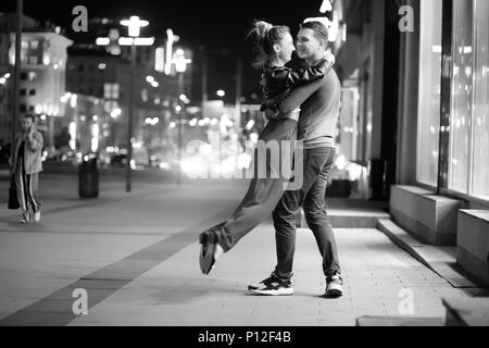Beautiful couple on a date in a night city outdoor - Stock Photo