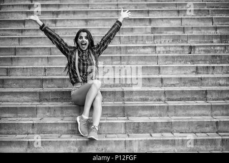 Cute girl in a clown makeup on a background black and white photo - Stock Photo