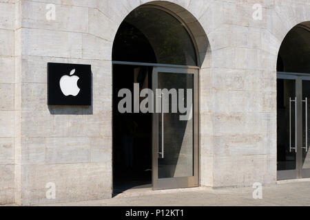 Berlin, Germany - june 09, 2018: Entrance and logo / brand emblem of APPLE on Apple store  facade in Berlin, Germany.   Apple Inc. is an American mult - Stock Photo
