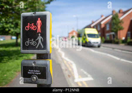 Toucan Crossing as an emergency NHS ambulance approaching near the Royal Shrewsbury Hospital  provide safe road crossings for pedestrians and cyclists - Stock Photo