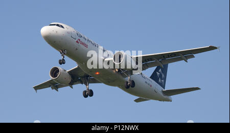 Swiss International Air Lines Airbus A320 HB-IJO in Star Alliance Livery coming into land at London Heathrow Airport LHR - Stock Photo