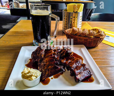 Mug of beer and plate of grilled pork ribs at Prague, Czech Republic - Stock Photo