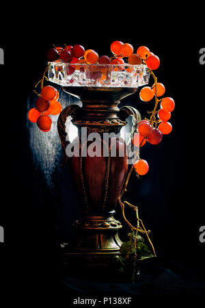 Grapes on old candle holder - Stock Photo