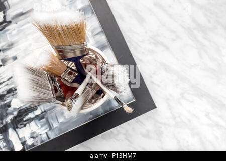 Paint brushes ready for a creative project. High angle view. - Stock Photo