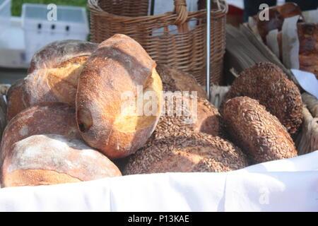 Fresh Baked Bread At The Farmers Market - Stock Photo