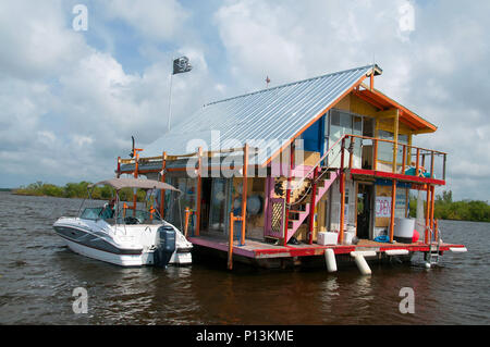 A floating bait shack is conveniently moored in the inland waters of Cape Coral. - Stock Photo