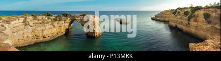 Panoramic view of the natural arch Arco  da Albandeira in the Algarve, Portugal. - Stock Photo