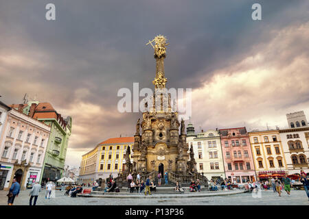 View of main square with monument Holy Trinity Column in historic town centre at sunset. Olomouc, Czech Republic - Stock Photo