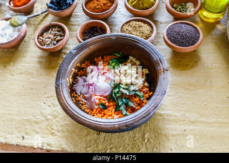 Bowl of ingredients for dahl to a traditional local recipe: lentils, chopped onions, garlic and leaves. Horagampita district, near Galle, Sri Lanka - Stock Photo