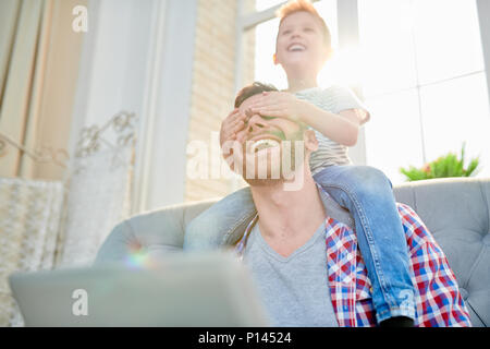 Enjoying Sunday with Cheerful Dad - Stock Photo