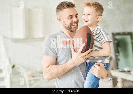 Playing Rugby at Home - Stock Photo