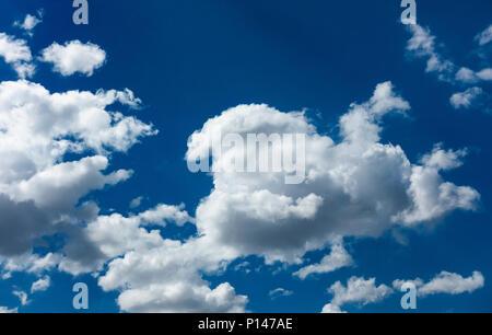 Cumulousnimbus clouds against a blue sky - Stock Photo