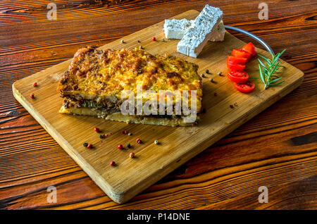 Moussaka. Greek traditional dish, that has three layers separately cooked before the final baking - Stock Photo