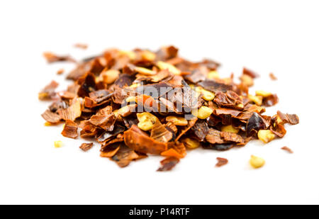 Dried crushed red pepper flakes - isolated, white background - Stock Photo
