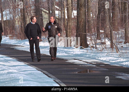 President George W. Bush and Prime Minister Tony Blair of the United Kingdom, walk a path at Camp David Feb. 23, 2001, during the Prime Minister's visit. - Stock Photo