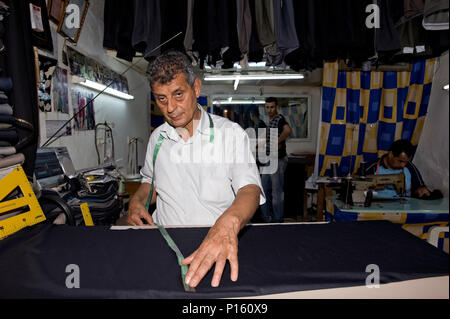 Tailor at work in the medina by the Ribat, Sousse, Tunisia - Stock Photo