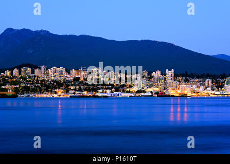 Vancouver city by night, British Columbia, Canada. Photographed from the Stanley Park. - Stock Photo