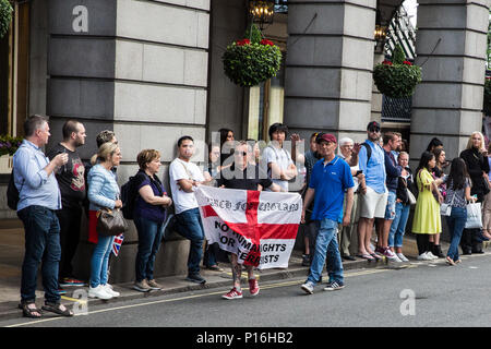 London, UK. 10th June, 2018. Members of a far-right group prepare to taunt hundreds of people taking part in the pro-Palestinian Al Quds Day march through central London organised by the Islamic Human Rights Commission. An international event, it began in Iran in 1979. Quds is the Arabic name for Jerusalem. Credit: Mark Kerrison/Alamy Live News - Stock Photo