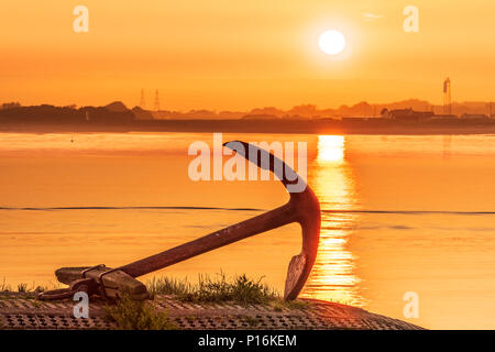 Appledore, UK. 11th May 2018. UK Weather - After a warm and humid night the sun rises over the Taw Torridge estuary and silhouettes the Anchor on the quayside at the little North Devon village of Appledore. Credit: Terry Mathews/Alamy Live News - Stock Photo