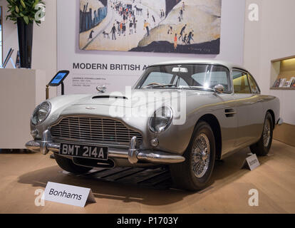 Bonhams, New Bond Street, London, UK. 11 June, 2018. Bonhams display the 1965 Aston Martin DB5 driven by James Bond (Pierce Brosnan) in the 1965 motion picture GoldenEye. It will be offered for sale at the Festival of Speed Sale, estimated £1,200,000-1,600,000. Credit: Malcolm Park/Alamy Live News. - Stock Photo