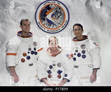 The prime crew of the Apollo 15 lunar landing mission. They are from left to right: Commander, David R. Scott, Command Module pilot, Alfred M. Worden and Lunar Module pilot, James B. Irwin. The Apollo 15 emblem is in the background. - Stock Photo