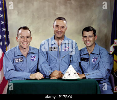 Portrait of the Apollo 1 prime crew for first manned Apollo space flight. From left to right are: Edward H. White II, Virgil I. 'Gus' Grissom, and Roger B. Chaffee. On January 27, 1967 at 5:31 p.m. CST (6:31 local time) during a routine simulated launch test onboard the Apollo Saturn V Moon rocket, an electrical short circuit inside the Apollo Command Module ignited the pure oxygen environment and within a matter of seconds all three Apollo 1 crewmembers perished. - Stock Photo