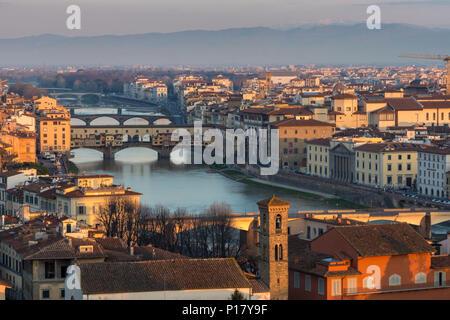Florence, Italy - March 24, 2018: Morning light illuminates the cityscape of Florence along the Arno River, including the landmark Ponte Vecchio bridg - Stock Photo