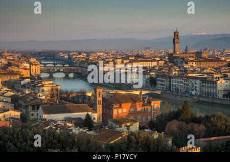 Florence, Italy - March 24, 2018: Morning light illuminates the cityscape of Florence, including the historic landmarks of the Palazzo Vecchio and Pon - Stock Photo