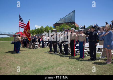 CHATTANOOGA, Tenn. – Attendees stand for the posting of the colors during a ceremony posthumously awarding the Navy and Marine Corps Medal to Gunnery Sgt. Thomas Sullivan and Staff Sgt. David Wyatt at Ross's Landing in Chattanooga, Tenn., May 7, 2017. Attendees of the ceremony included Maj. Gen. Burke W. Whitman, commanding general of 4th Marine Division, Sgt. Maj. Michael A. Miller, sergeant major of 4th MARDIV and family members of GySgt Thomas Sullivan and SSgt David Wyatt. - Stock Photo