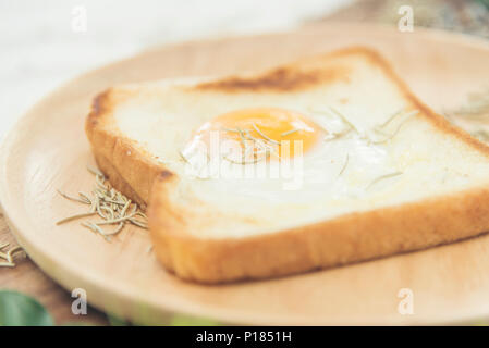 Breakfast consists of fried bread egg and vegetables. - Stock Photo