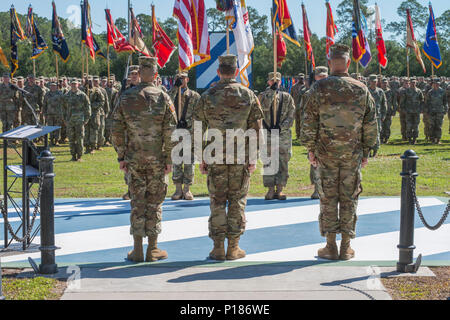 Maj. Gen. Leopoldo Quintas, left, incoming Commander of 3rd Infantry Division, Gen. Robert Abrams, center, Commander U.S. Forces Command, and Maj. Gen. James Rainey, right, outgoing Commanding General 3rd Infantry Division, stand in front of the assembled 3rd Infantry Division. The 3rd Infantry Division change of command ceremony was held on Cotrell Field at Fort Stewart, GA, May 8, 2017. - Stock Photo
