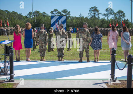 Maj. Gen. Leopoldo Quintas and his family, left, Gen. Robert Abrams and his wife, center, and Maj. Gen. James Rainey and his family, right, participate in the pass and review. The 3rd Infantry Division change of command ceremony was held on Cotrell Field at Fort Stewart, GA, May 8, 2017. - Stock Photo