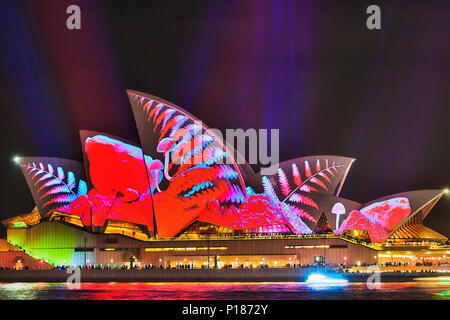 Sydney, Australia - 25 May, 2018: Sydney city landmark of Sydney Opera House at harbour waterfront during annual light show of music, light and ideas  - Stock Photo