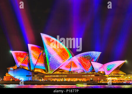 Sydney, Australia - 25 May, 2018: Sydney city landmark of Sydney Opera House at harbour waterfront light painted during annual light show of music, li - Stock Photo