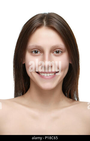 Portrait of a young pretty girl without make up. model having beatiful face with nice smile, plump lips, big eyes and white teeth. Dark brown hair, opened shoulders. White studio background. - Stock Photo