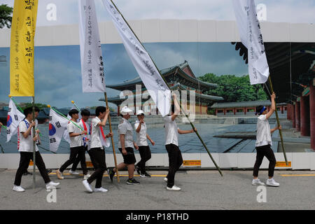 Korean schoolchildren holding South Korean flags reenact the March 1st Movement, also known as Sam-il Movement against Japanese colonial rule that occurred on March 1, 1919, hence the movement's name, in the city of Seoul capital of South Korea - Stock Photo