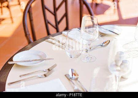 Classic Dinnerware in the restaurant. Table appointments for dinner on terrace - Stock Photo