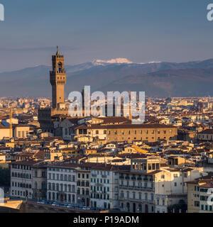Florence, Italy - March 24, 2018: Morning light illuminates the cityscape of Florence, including the historic landmark of the Palazzo Vecchio. - Stock Photo
