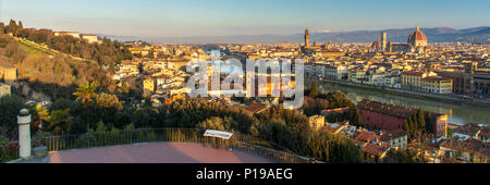 Florence, Italy - March 24, 2018: Morning light illuminates the cityscape of Florence, including the historic landmarks of Ponte Vecchio, Palazzo Vecc - Stock Photo