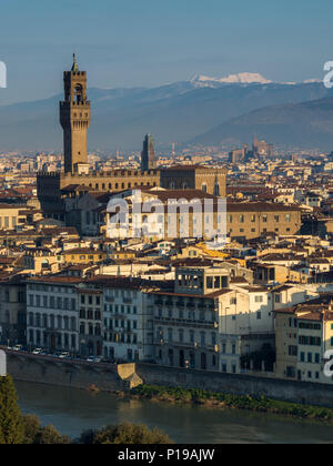 Florence, Italy - March 24, 2018: Morning light illuminates the cityscape of Florence, including the historic landmark of the Palazzo Vecchio. - Stock Photo