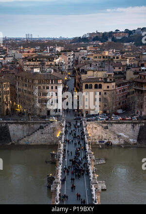 Rome, Italy - March 24, 2018: Pedestrians cross the River Tiber on the Ponte Sant'Angelo in Rome. - Stock Photo