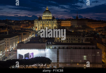 Rome, Italy - March 24, 2018: St Peter's Basilica and the Vatican City are lit up at sunset. - Stock Photo