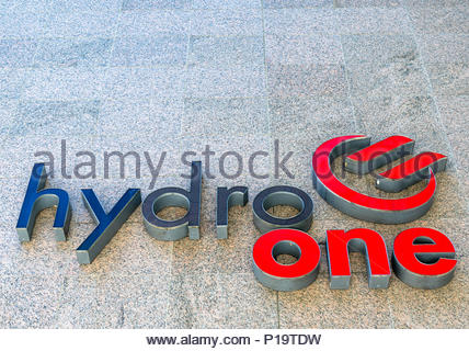 Hydro One sign and logo in the wall of the headquarter building in the downtown district - Stock Photo