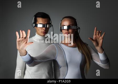 Couple working with futuristic display using futuristic VR goggles, innovation, future concept - Stock Photo