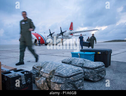 Crew members aboard an HC-130 Hercules airplane from Air Station Clearwater deliver medical supplies to Guantanamo Bay, Cuba Thursday, Oct. 6, 2016 to support post Hurricane Matthew relief efforts. U.S. Coast Guard photo by Petty Officer 1st Class Michael De Nyse - Stock Photo