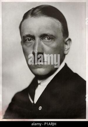 GERMANY - 1923: Studio portrait of Adolf Hitler, leader of nazi Germany. Reproduction of antique photo. - Stock Photo