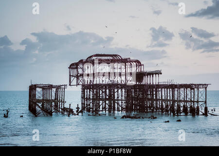 Burned West Pier by the sea, Brighton, England - Stock Photo