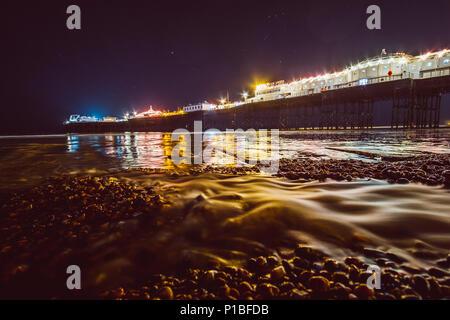 Brighton pier at night, Brighton, England - Stock Photo