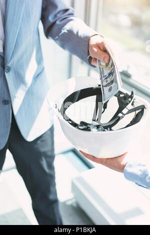 Immoral politician giving a bribe - Stock Photo