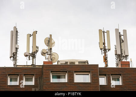 Telecommunication antennas on the roof of the building. - Stock Photo